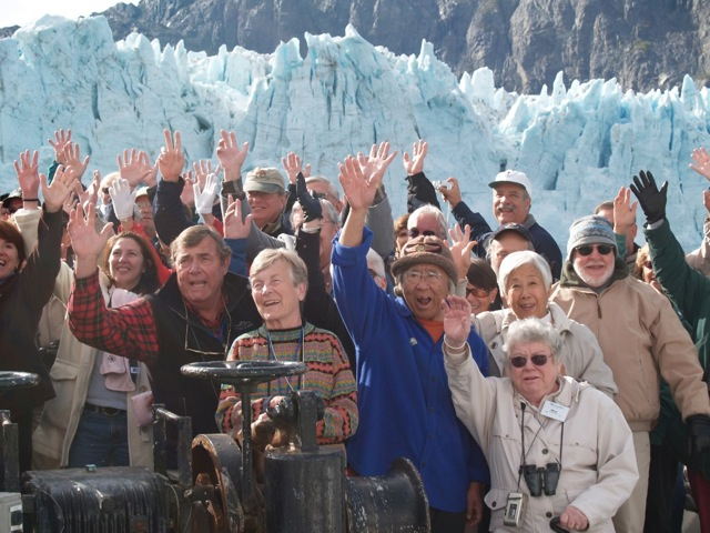 Wave for the camera! For some in this photo, taken in 2006, seeing the glaciers of Alaska was the last thing on their bucket lists. At least two people had terminal illnesses. © Ralph Grizzle