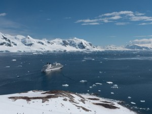 Seabourn Quest in Neko Harbor. Note the dots in the snow: guests from the ship climbing to the top of the mountain where I snapped this photo. © 2014 Ralph Grizzle