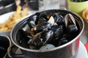 Enjoy a pot of mussels (with French fries)  in Marseille's Old Port. © 2014 Avid Travel Media