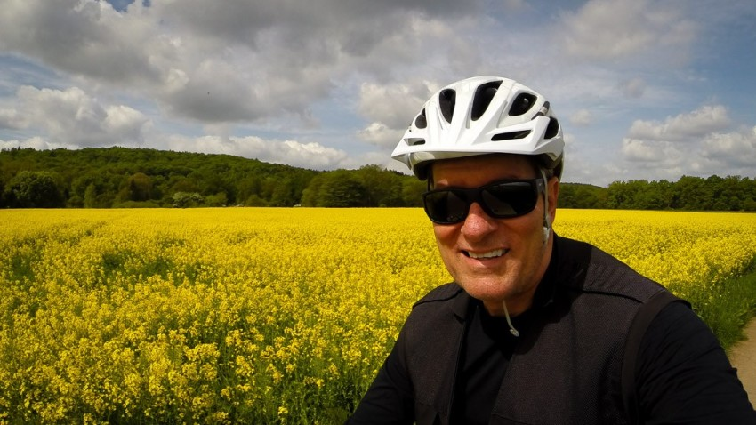 Pedaling past fields of canola. © 2015 Ralph Grizzle