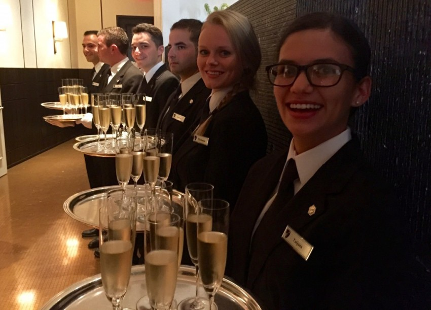 Six Seabourn team members left their ships in Europe to serve champagne in New York. © 2015 Ralph Grizzle