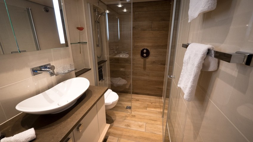 Spacious marble bathroom in my loft stateroom on ms Savor. © 2015 Ralph Grizzle