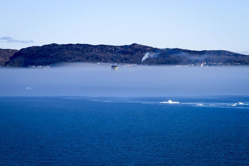 Disko Bay, with a ship shrouded in fog. © 2010 Ralph Grizzle