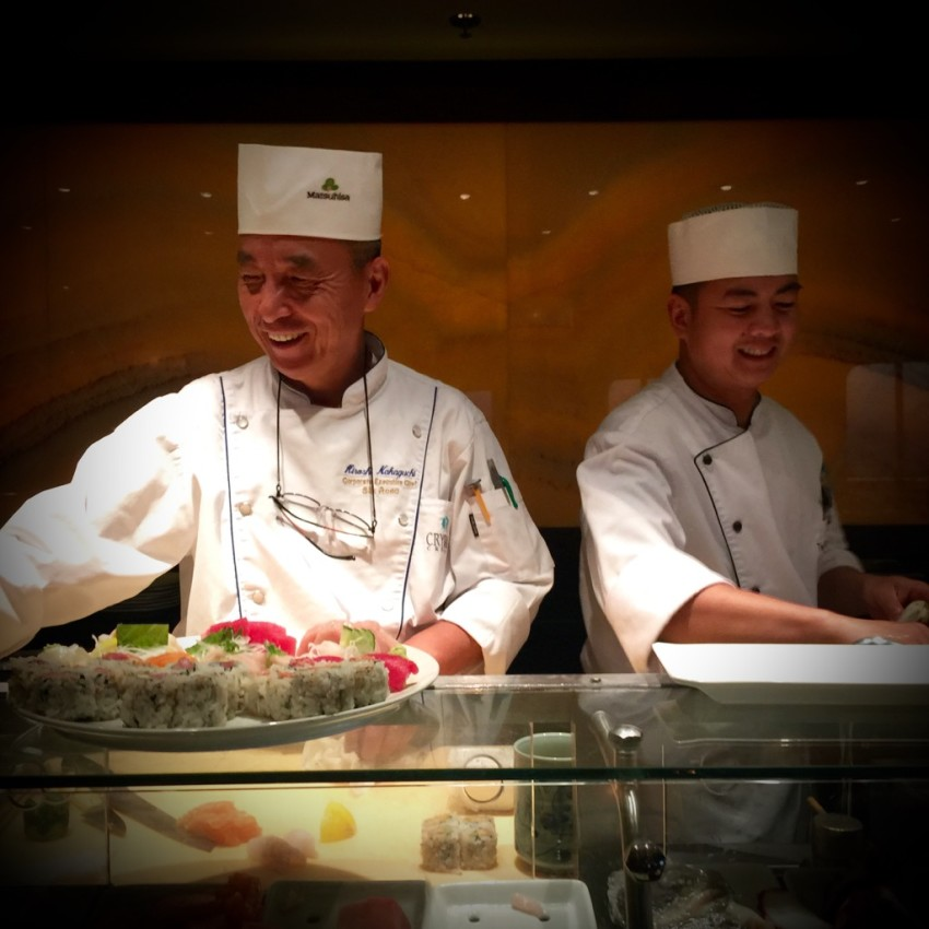 Sushi chefs enjoying their craft. © 2015 Ralph Grizzle