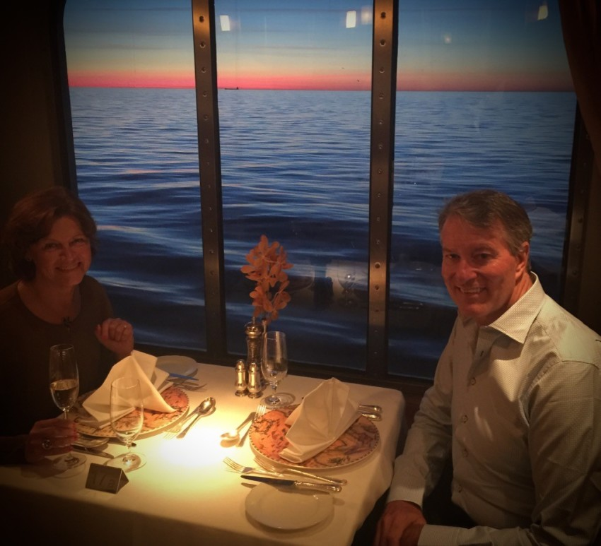 "An Avid Cruiser reader asks if tables for two are guaranteed on Crystal Cruises. No, but they are easy to come by in the Crystal Dining Room. Last week on Crystal Symphony, we dined at a ""table for two with a view"" with a gorgeous sunset on the Baltic Sea. © 2015 Ralph Grizzle"