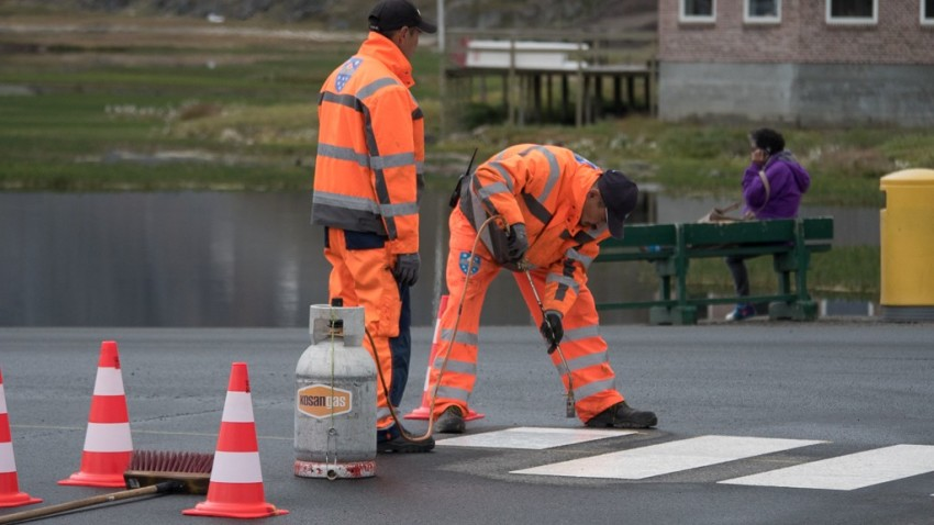 Yes, there is traffic in Sisimiut, and new crosswalks. © 2015 Ralph Grizzle