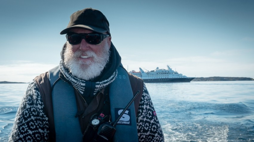 Silver Explorer Expedition Team Member John at the wheel of the Zodiac. © 2015 Ralph Grizzle