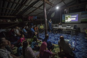 Staff from G Adventures' Planeterra Foundation (Adrienne Lee) providing training and answering questions for indigenous hilltribes of Northern Thailand, in preparation for the communities' welcoming travelers on the Northern Thailand Hilltribes Trek.