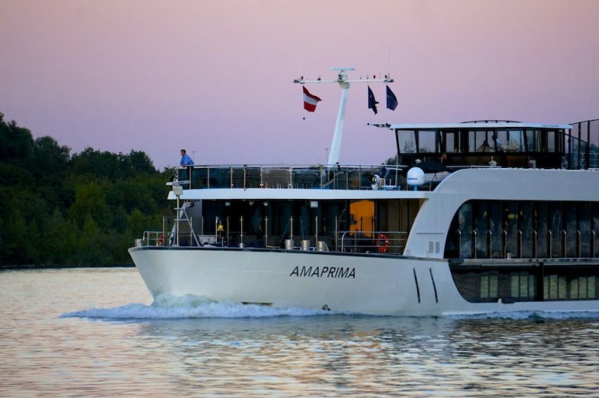 AmaPrima under a pink dusk sky on the Danube, approaching Vienna.