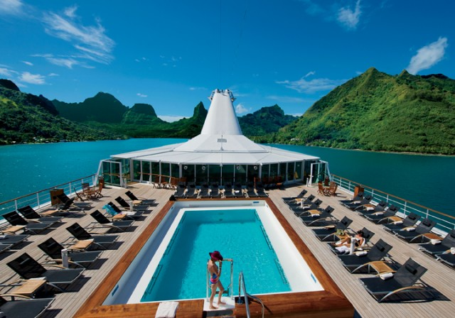 The spacious pool deck of the Paul Gauguin is perfect for soaking in the Tahitian sun.