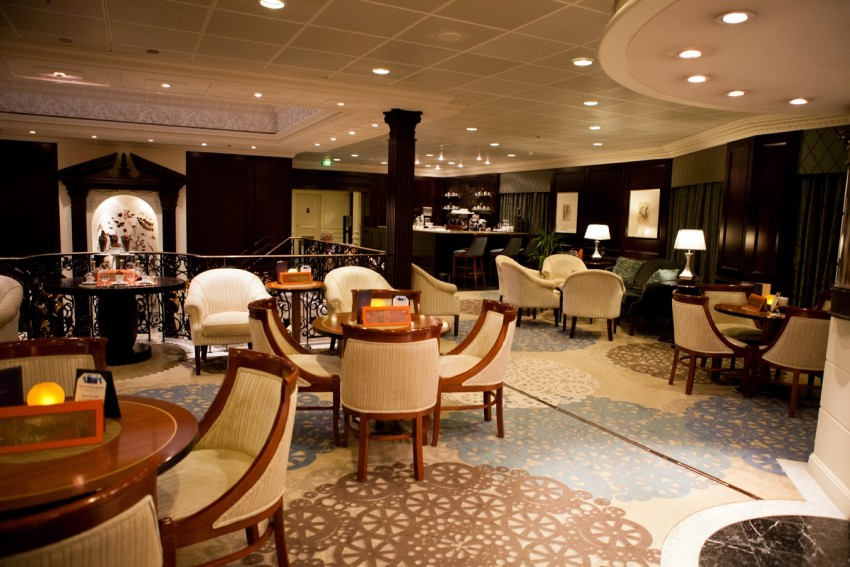 The Mosaic Lounge aboard Azamara Journey features a clubby, intimate ambiance. Note that furniture and carpeting has been replaced since this press photograph was issued.