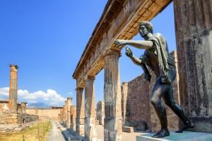 Bronze statue of Apollo at temple ruins