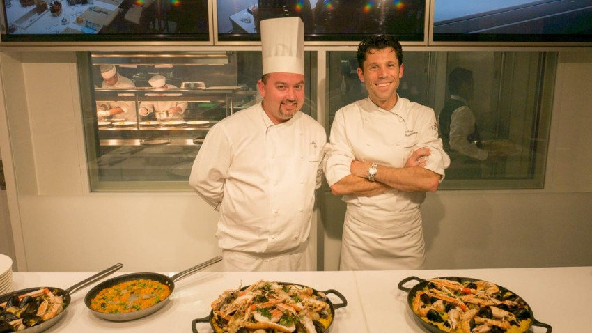 Proud of Their Paella Anthony Mauboussin, director of culinary development for Viking Ocean Cruises, and Ashley Duff, executive chef, proud of their paella.
