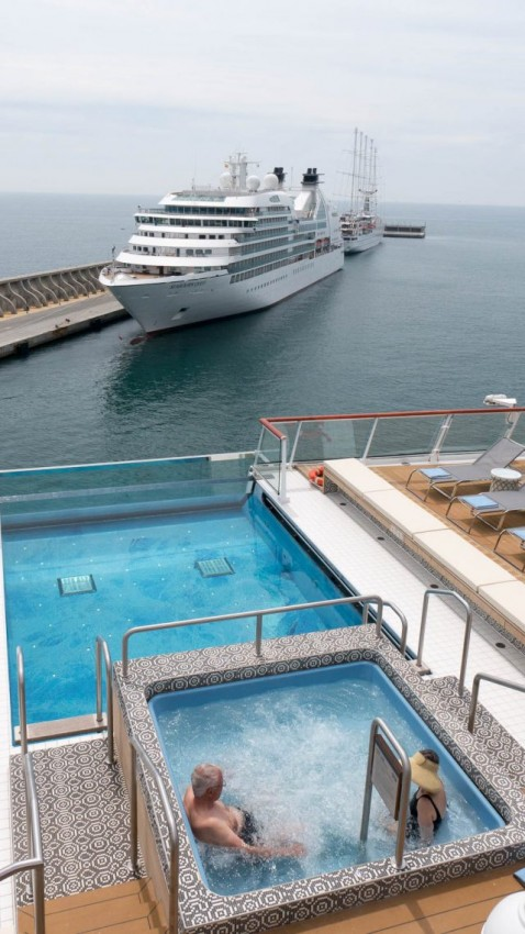 Viking Sea's aft infinity pool and Jacuzzi with Seabourn Quest in the background.