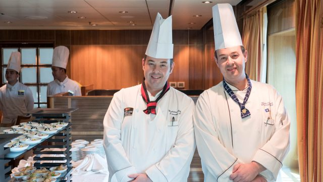Cunard's twin Executive Chefs, Nicholas and Mark Oldroyd, and their team are preparing more than 17,000 meals daily for crew and contractors on Queen Mary 2.