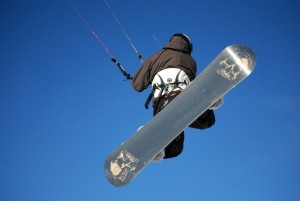 A snowboarder soaring over the icy hills of St Moritz