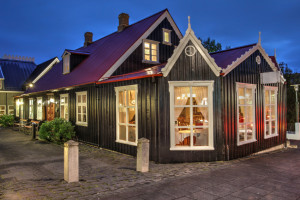 Traditional old house on Laugavegur Street in Reykjavik, Iceland at twilight time