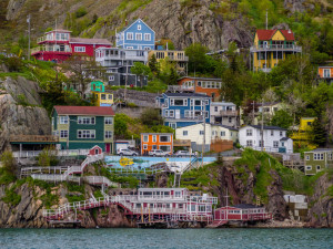View of beautiful colorful houses built on the rocky slope of the Signal Hill in St. John's Newfoundland, Canada