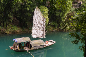 Traditional yacht boat along scenic river in Three Gorges