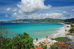View of Grand Anse beach and tropical coast of Grenada island from coastal promenade