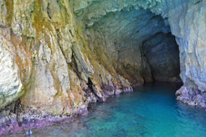 The attraction of the Amalfi coast - Green grotto with colorful walls and emerald water