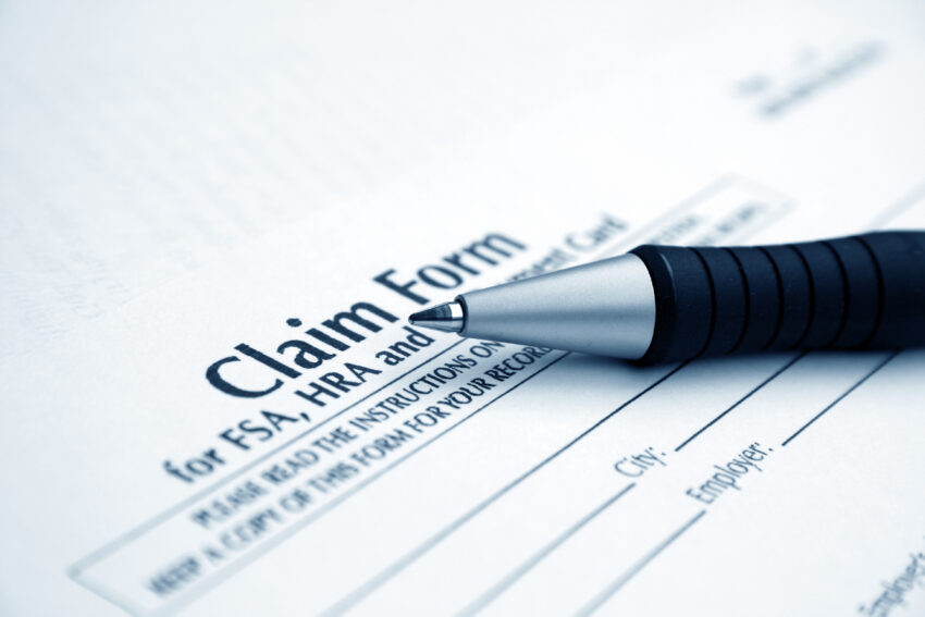 Pen lying on claim form