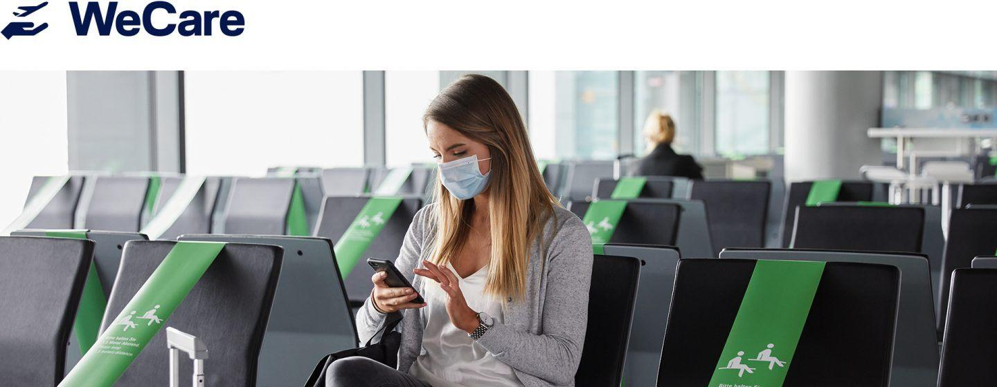 Woman on phone at airport with mask on