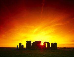 Stonehenge with sunset behind it